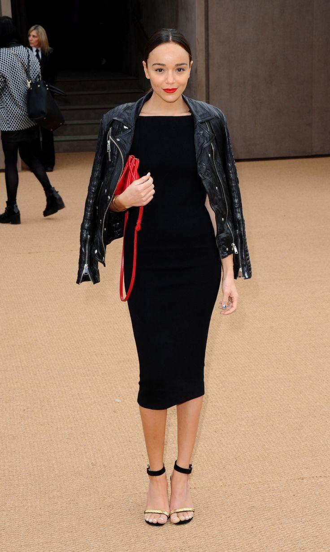 Ashley madekwe wearing black leather biker jacket black midi dress black and gold suede heeled sandals red leather crossbody bag