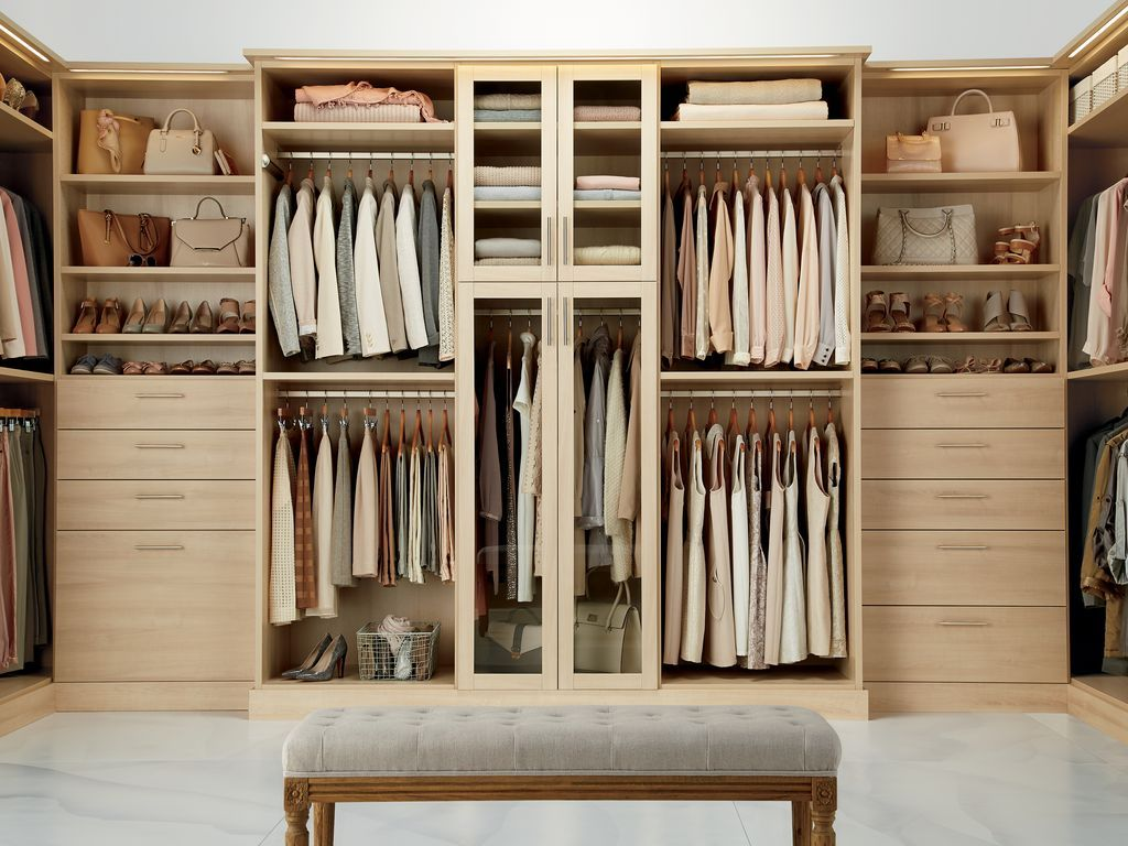 Transitional closet with high ceiling california closets custom closet concrete floors built