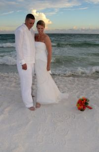 Beach wedding bride and groom, wearing a Debra Torres
