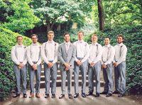 the groom and his groomsmen. grey suit. suspenders with ...