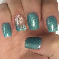 Frozen inspired Christmas snowflakes nail art design ...