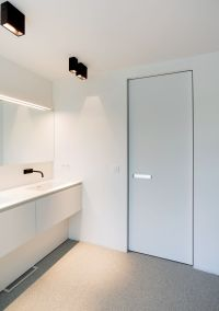 White interior door with invisible door frame and a built ...