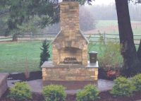 """Stone Age 36"""" fireplace with custom hearth. 