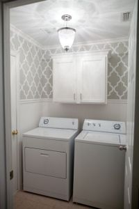 laundry room with wallpaper wainscoting. The after photo ...