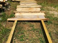 Create this simple scrap wood walkway in your yard. It's a