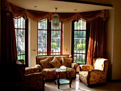This is a beautiful set up with a great example of formal swag - swag curtains for living room