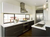 mid century modern kitchen with two tone cabinets ...