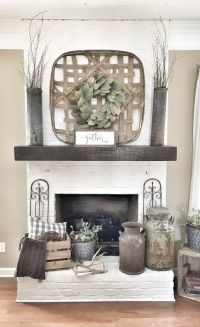 Painted white brick fireplace. Tobacco basket over ...
