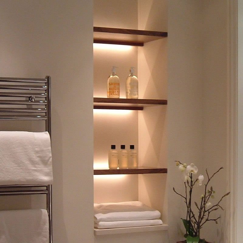 Open a wall between studs to store towels and decorative items - decorative towels for bathroom ideas
