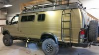 Sportsmobile with Aluminess bumpers, ladder and roof rack ...