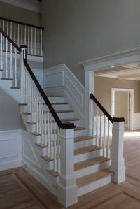 newel post, light oak floors w/dark railing   staircase ...
