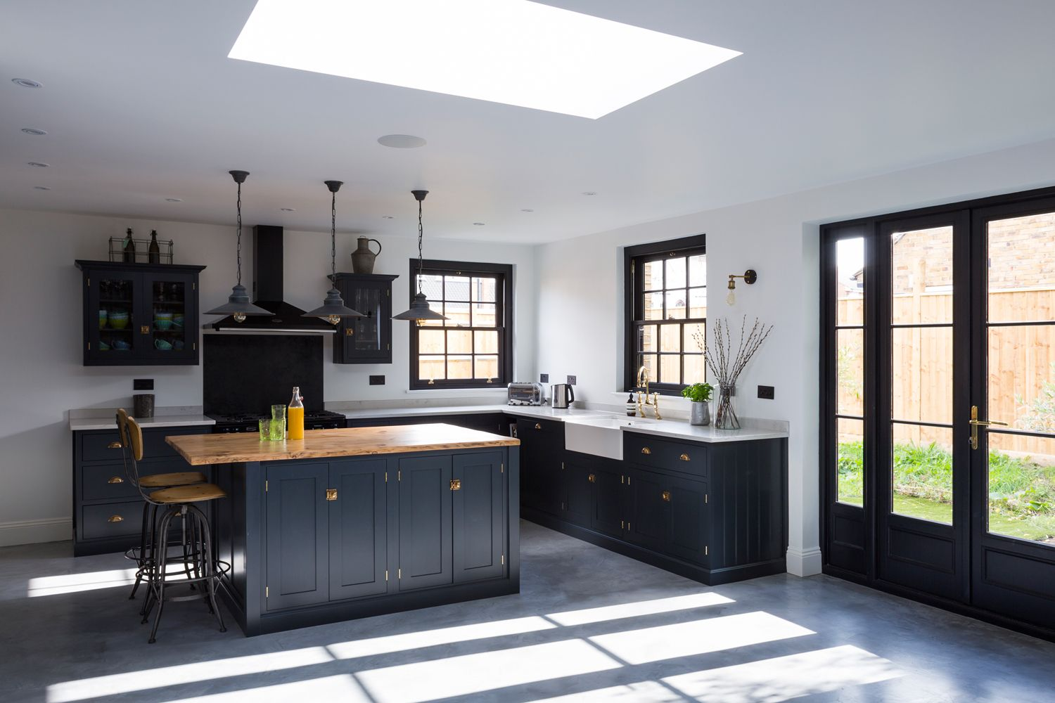 concrete floor kitchen A beautiful contemporary deVOL Shaker Kitchen with polished concrete floor deep grey blue cabinets