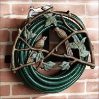 Ideas, Amazing Garden Hose Holder Made From Wrought Iron ...