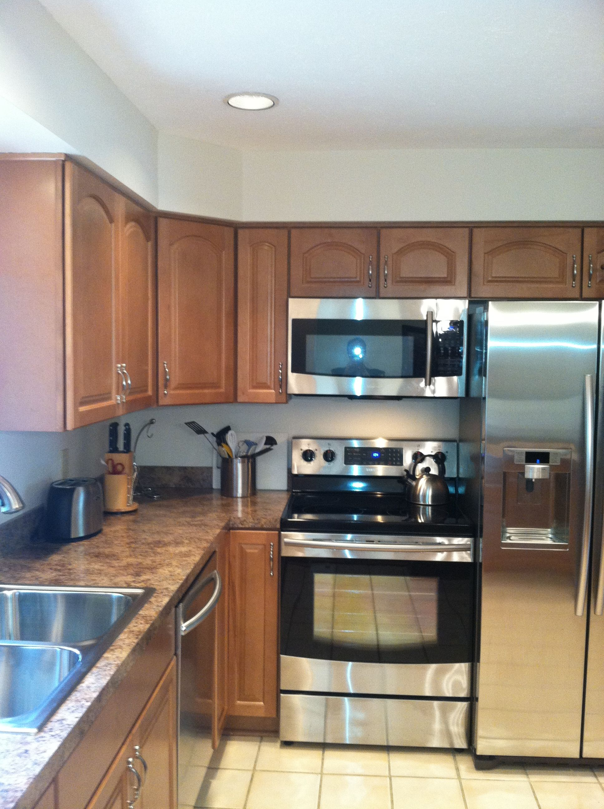 Countertops Definition Stainless Steel And Black Appliances With Waypoint Maple