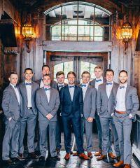 handsome grey tux groomsmen attire with blue bowties ...