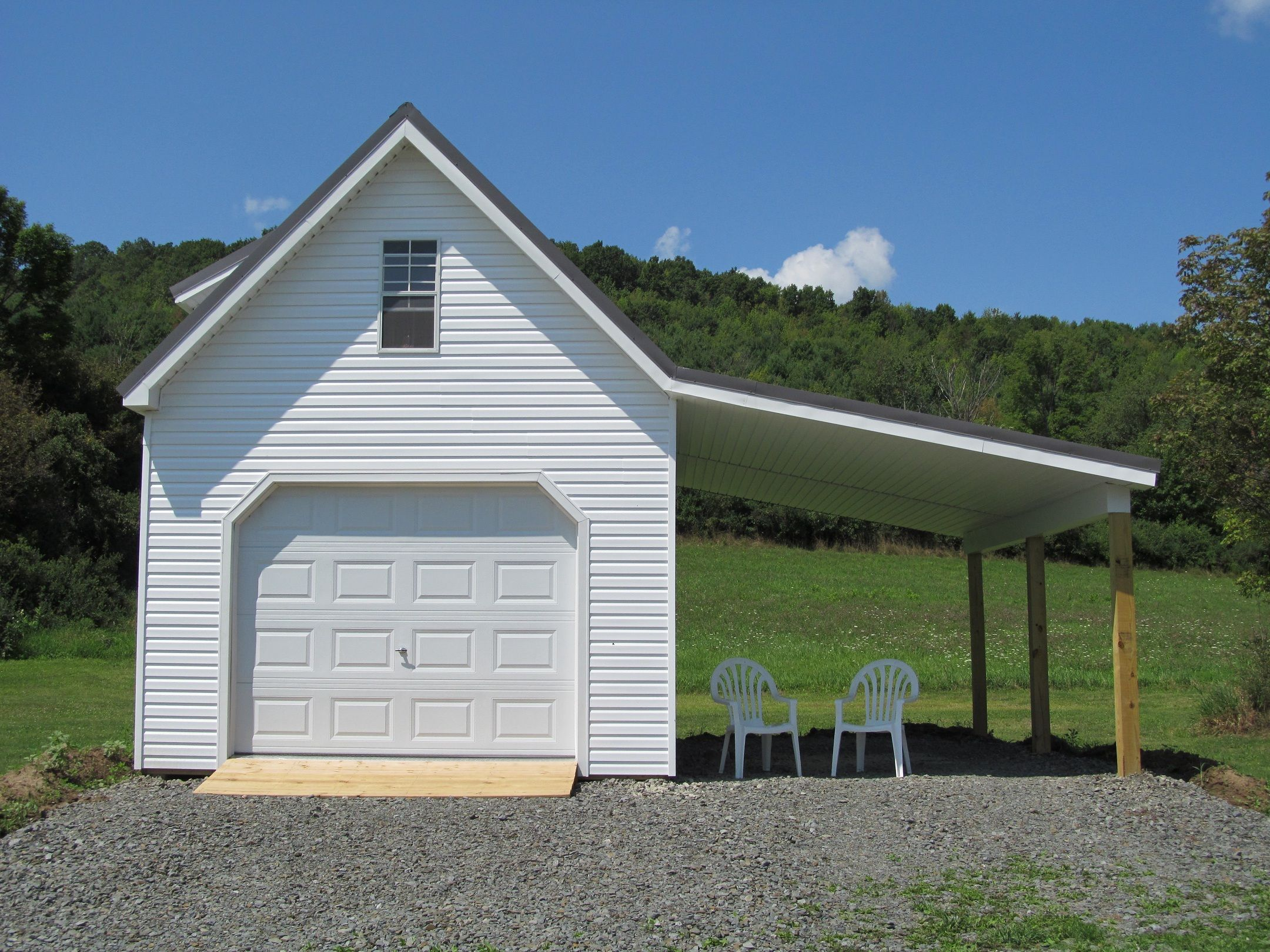 Singlewide Garage With A Dormer And An Overhang Garages
