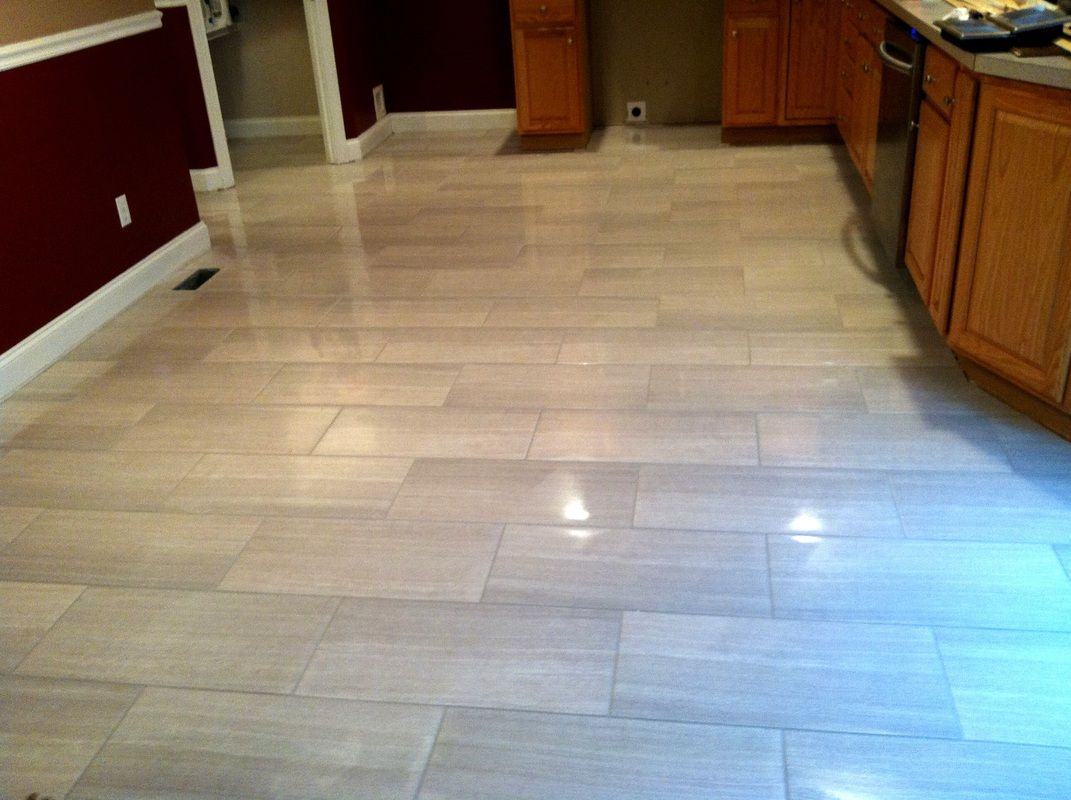 flooring for kitchen Modern kitchen floor tile by Link Renovations linkrenovations