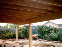 A solid roof patio cover under construction | Covered ...