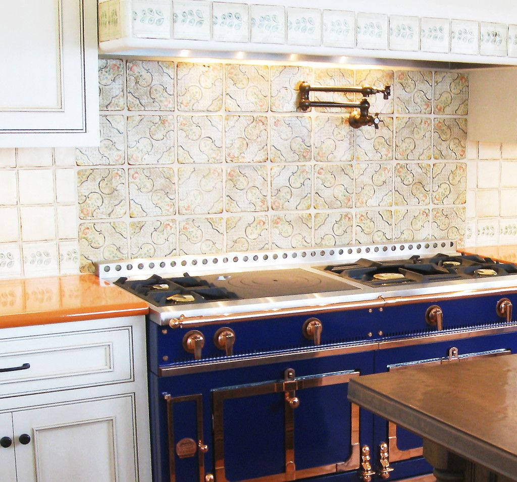 Spanish Tile Countertops Orange Lavastone Counter With Blue French Range And