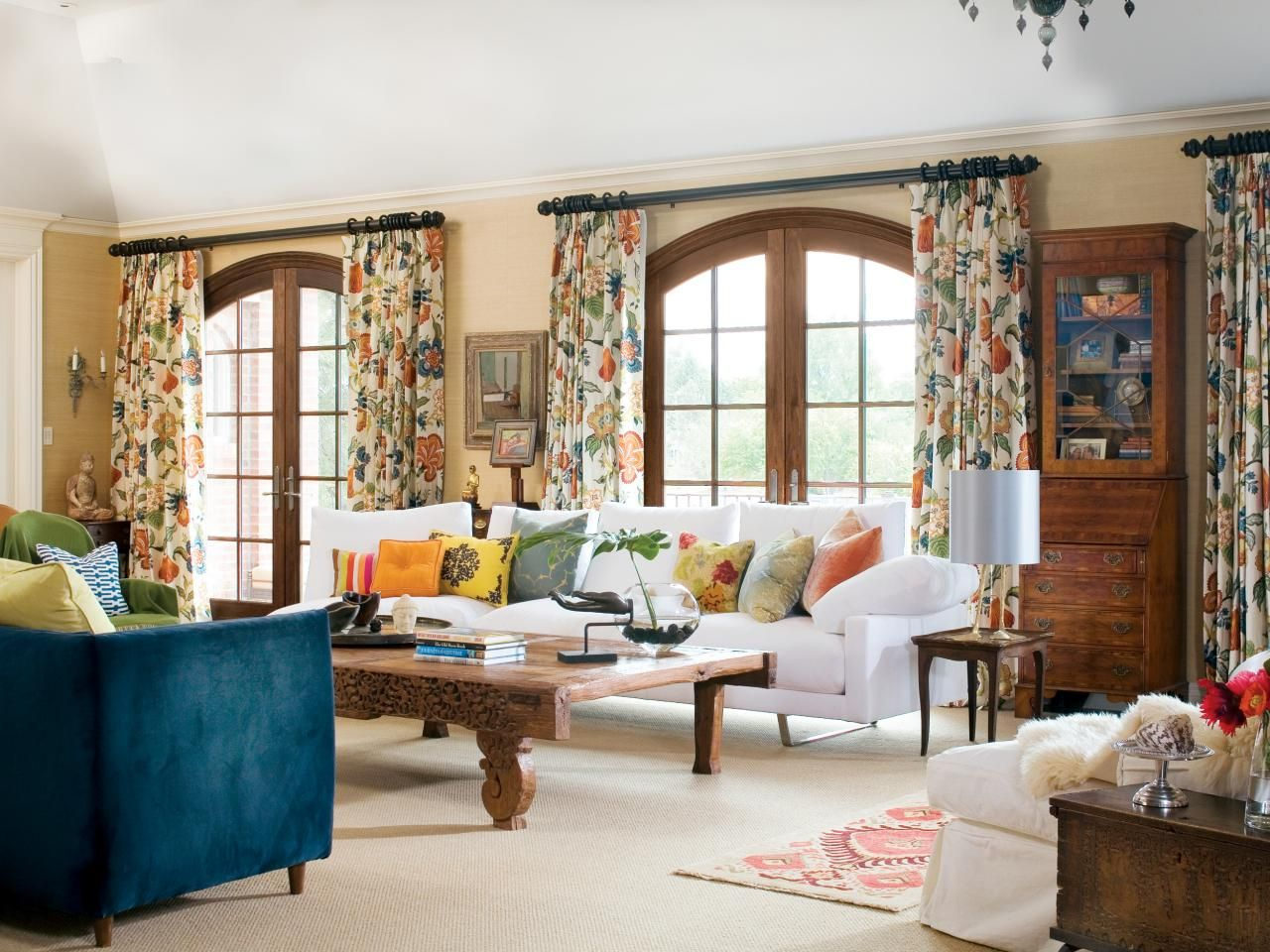 These patterned floral drapes pull accents from all over the living room and compliment the french