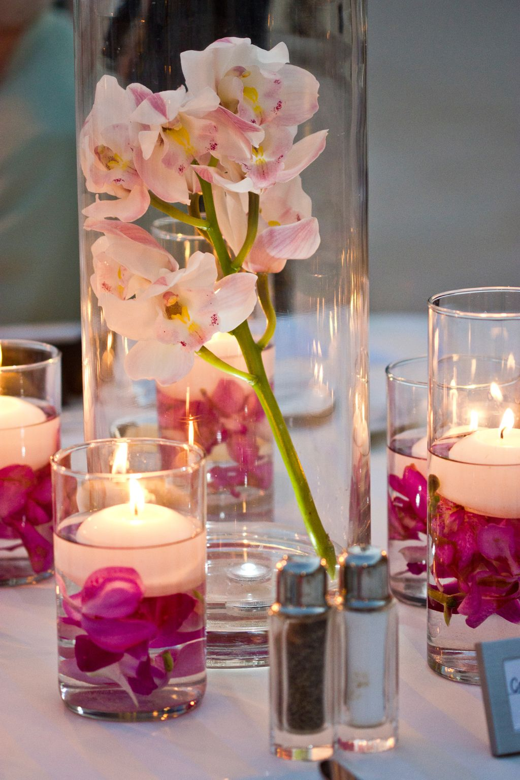 Candles With Gifts Inside Maui Wedding Orchid Centerpieces With Floating Candles By
