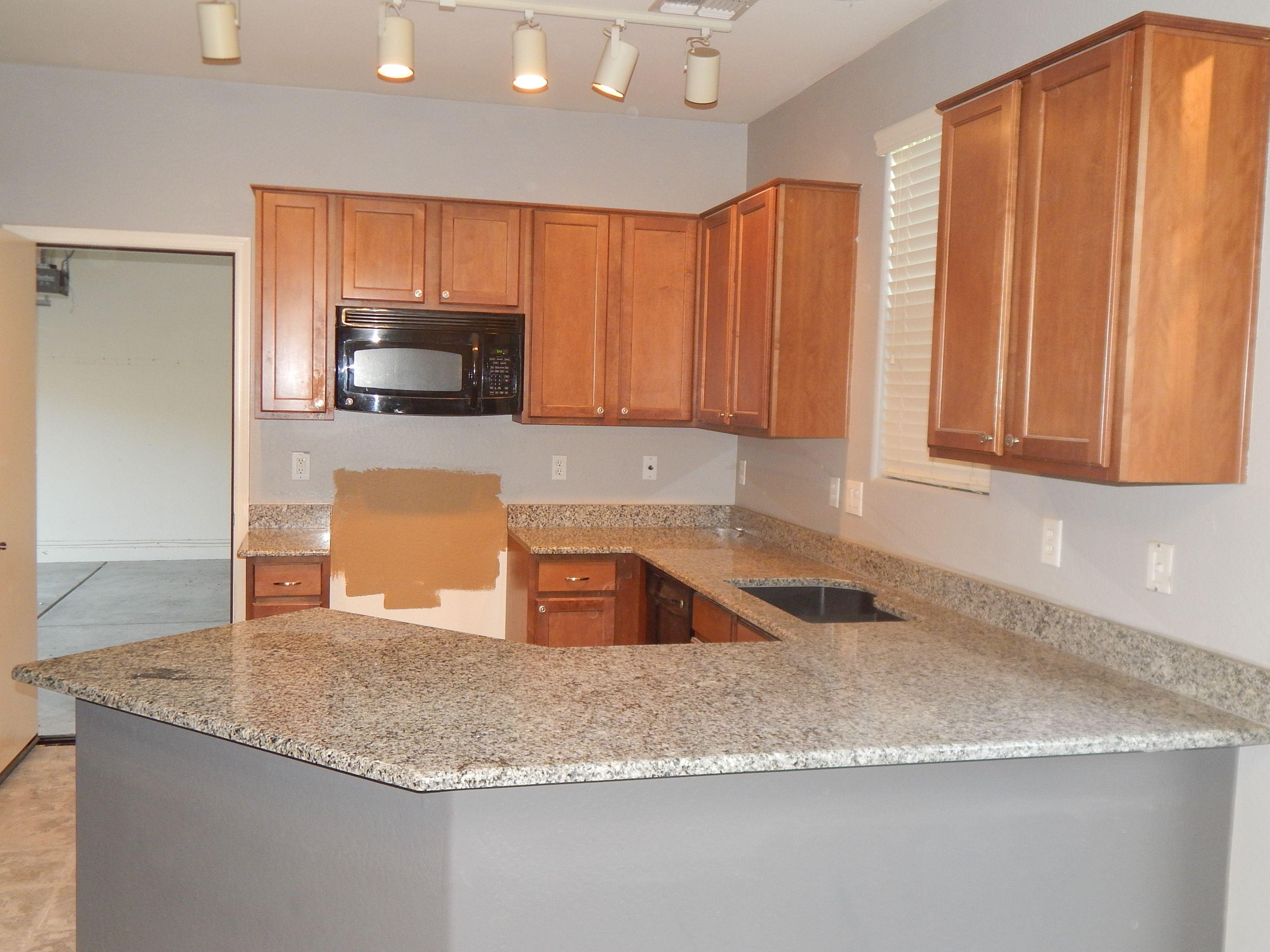 Kitchen remodel with azul platino granite and top radius edge call for a free estimate