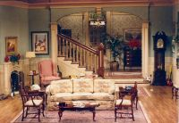 Setting for scenes 3, 4, and 5. A rich 1980's living room