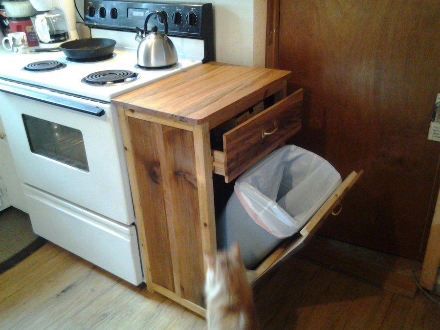 Pallet board used to make a trash can cabinet Kathi Kountry - kitchen trash can ideas