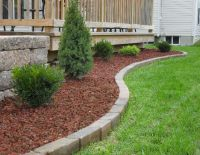 red lava rock with brick edging | curb appeal | Pinterest ...