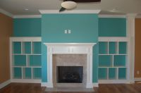 Fireplace with shelves on each side. Add a splash of color