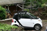 Smart Car with Tandem bike and roof rack loaded on top   I ...