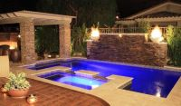 Stacked stone wall with waterfalls make this pool ...