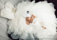 Baby Olivia in mommy's wedding dress... how cool is this ...