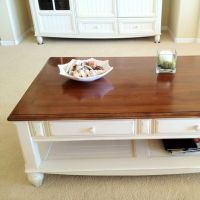 Coffee table with brown wooden top and white wood bottom ...