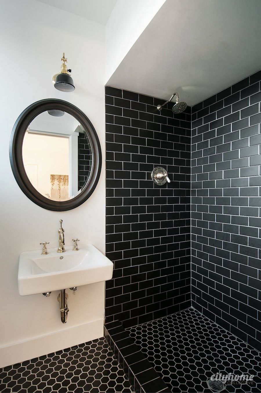 Modern bathroom black subway tile brass fixtures white wall mounted sink beautiful