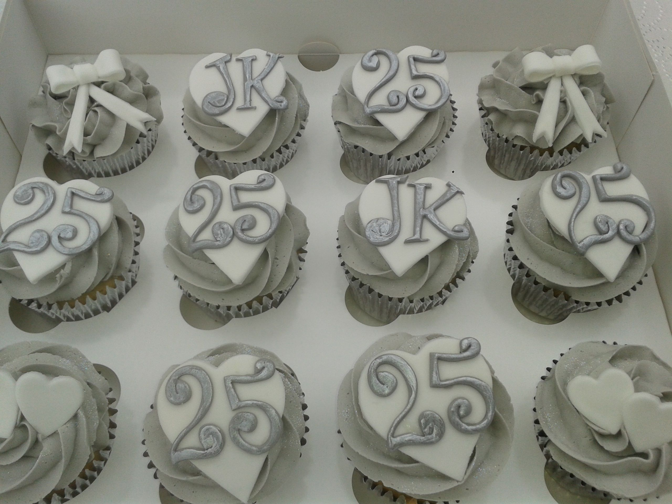 25th wedding anniversary Vanilla cupcakes in silver foil cake cases topped with a swirl of vanilla butter cream finished 25th Wedding Anniversary