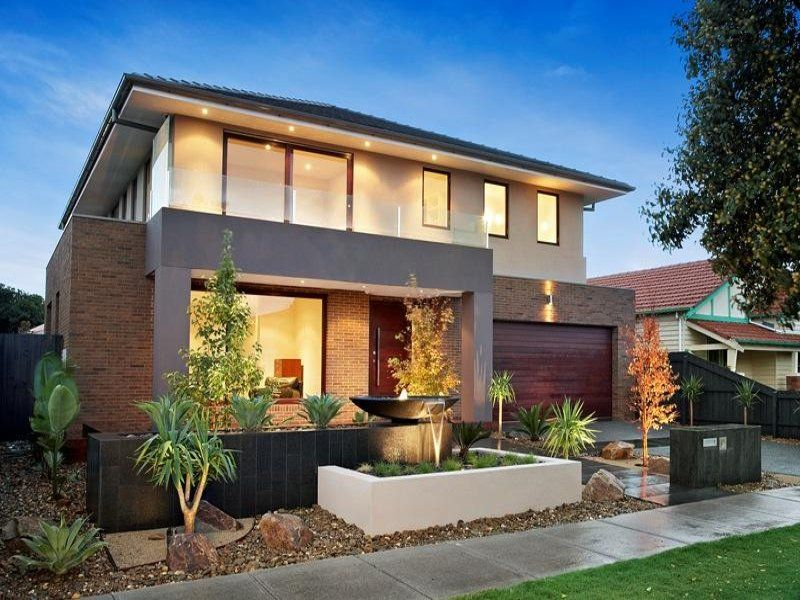 Brick modern house exterior with balcony & fountain