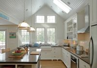 White kitchen, love the vaulted ceiling and windows. The ...