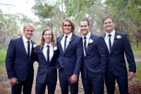 groomsmen ties with navy suits and bridesmaids in navy
