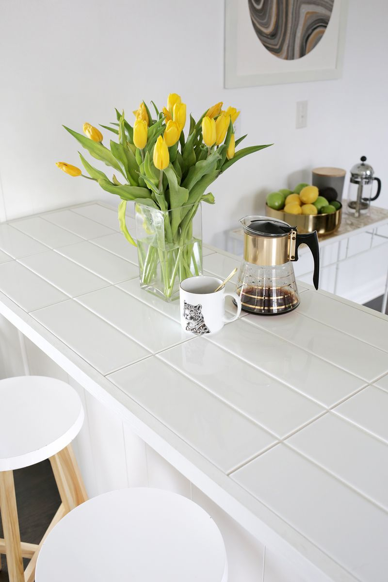 tile kitchen countertops Kitchen Mini Makeover with Affordable Tiled DIY Marble Countertops and Aged Copper Light Fixture Alternative Countertops and Over the