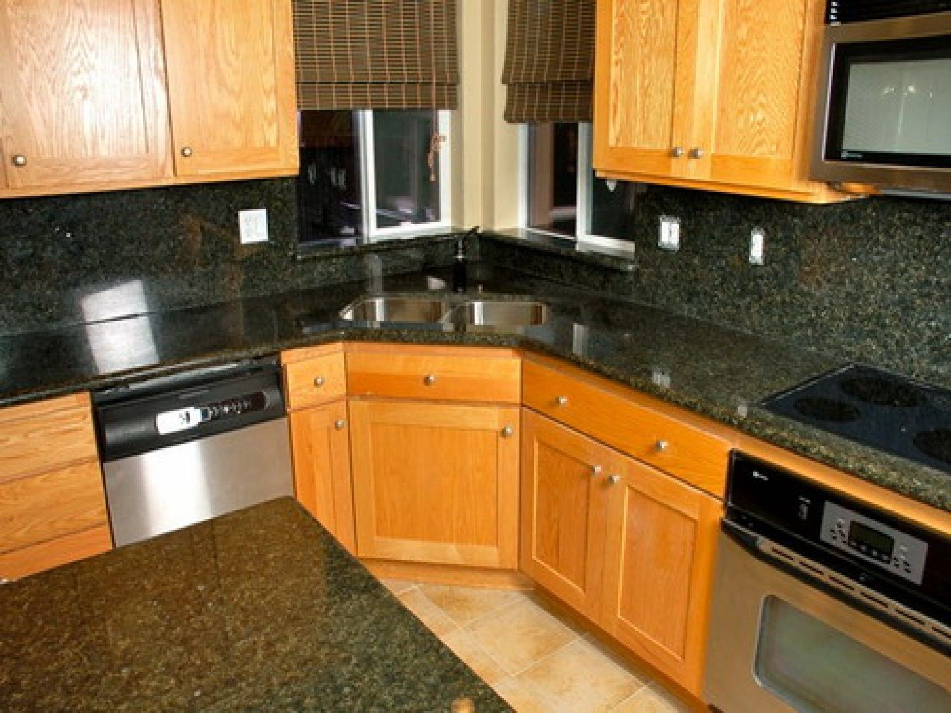 Oak Cabinets With Granite Countertops Pictures Ivory Oak Kitchen Cabinet With Black Granite Counter Tops