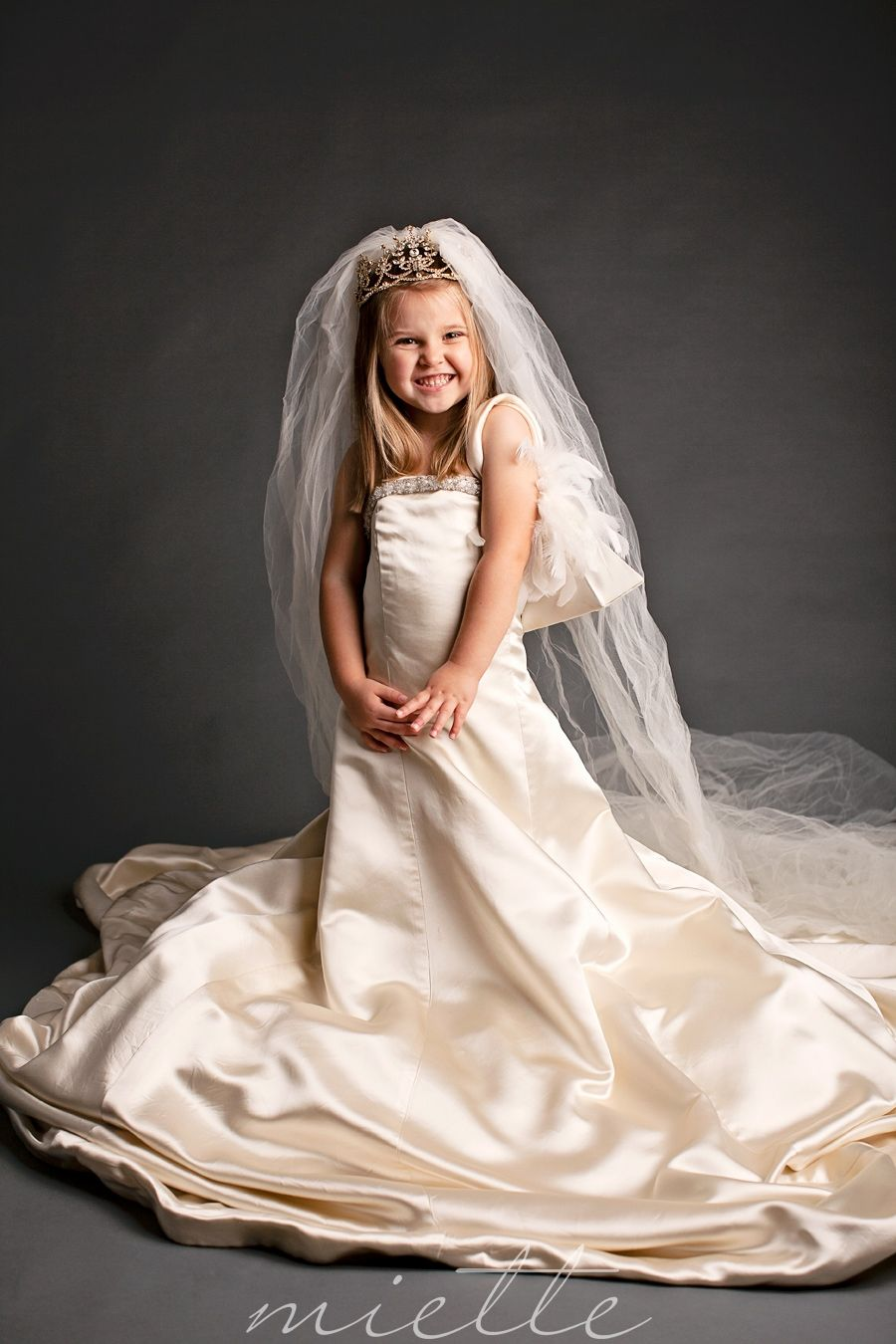 mothers wedding dresses A little girl dresses up in her mother s wedding dress