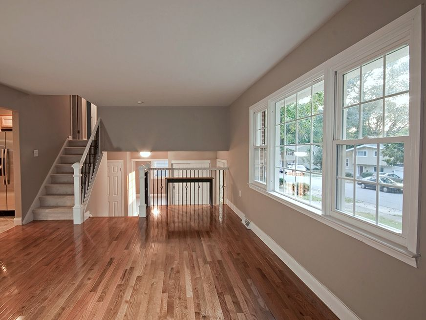 Gleaming hardwood floors plus a gorgeous paint color in the living - living room with wood floors
