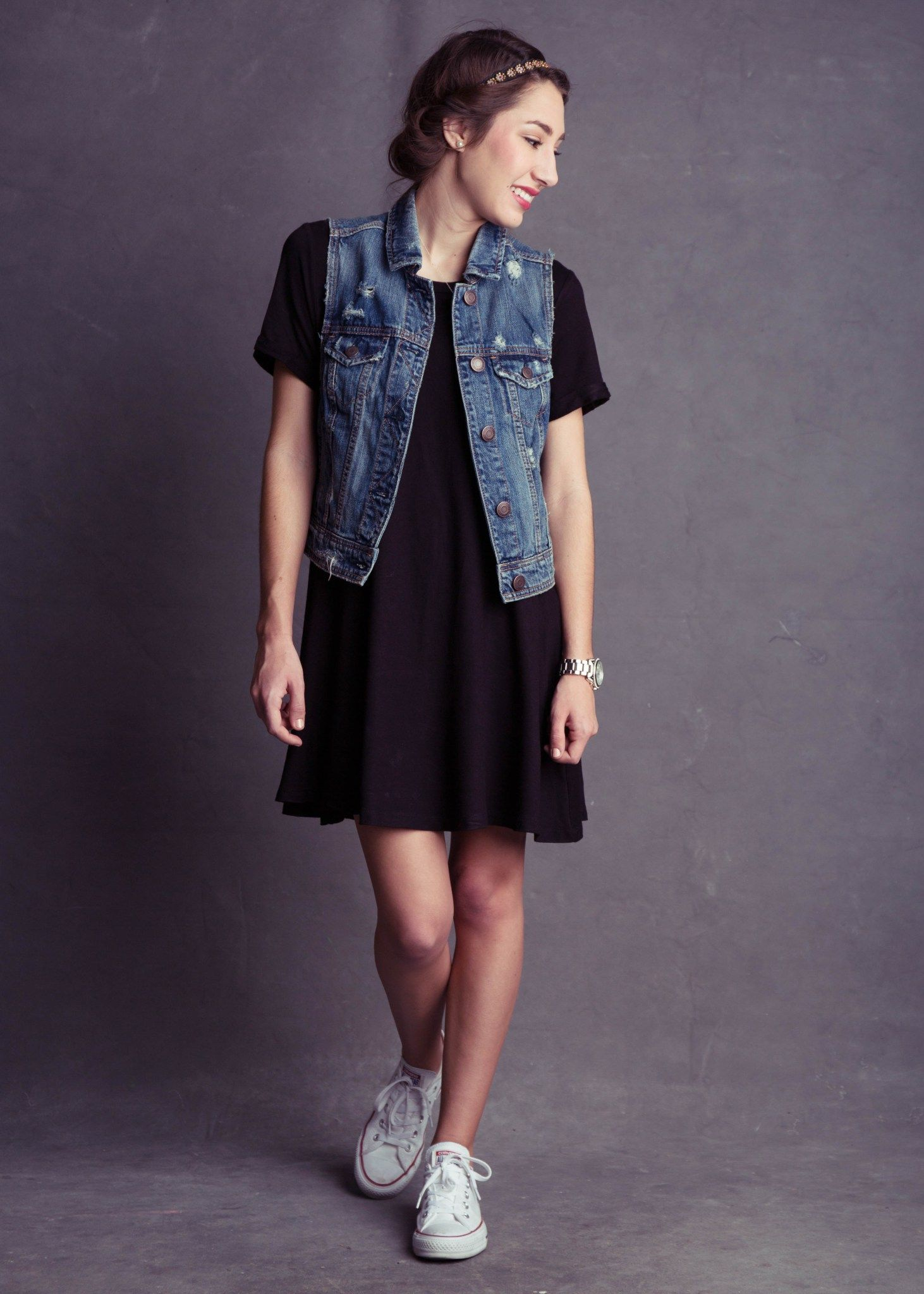 American eagle jean vest with black t shirt dress and white converse with princess rolled