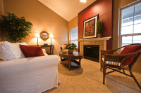 Living Room: light caramel color with red fireplace accent ...