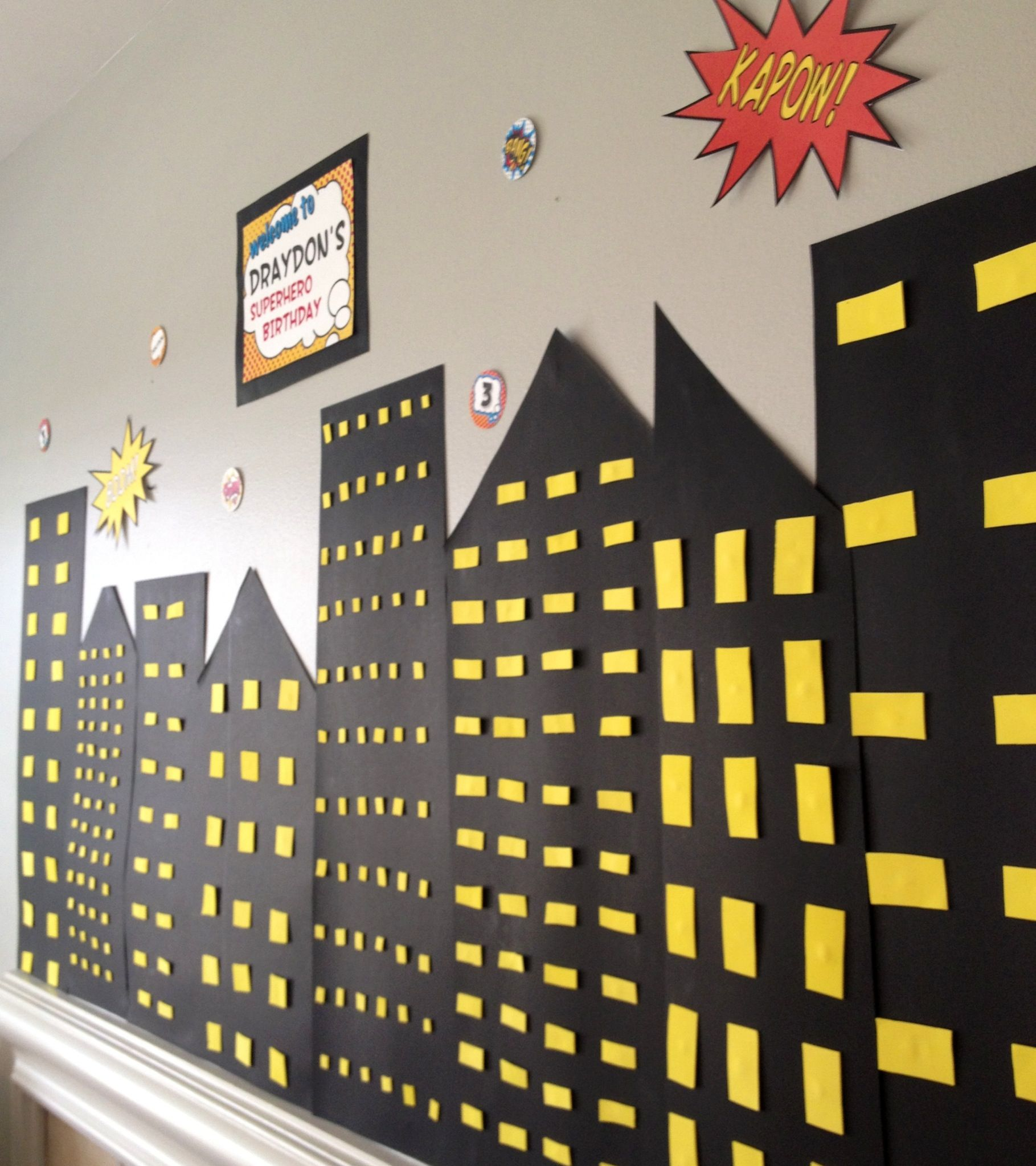 Superhero birthday party would be easy to do on a wall with black poster board superhero backgroundsuperhero backdropsuperhero