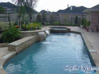 Lap pool with a stacked stone back wall | Pools ...