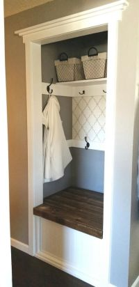 Hallway Closet Makeover DIY with a bench seat that opens