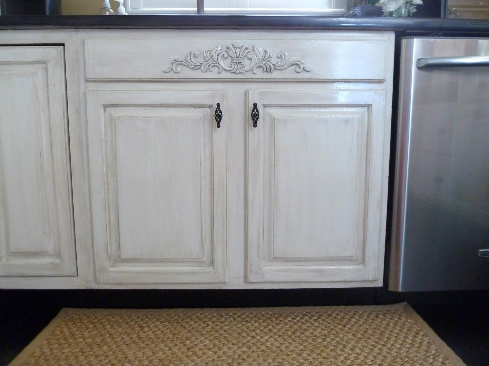 white appliances make it work paint kitchen cabinets white Distressing white cabinets with glaze and sandpaper Also added a piece of decorative moulding Lowe s to the area under the sink