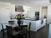 This is my kitchen. Dark floors white cabinets and black ...